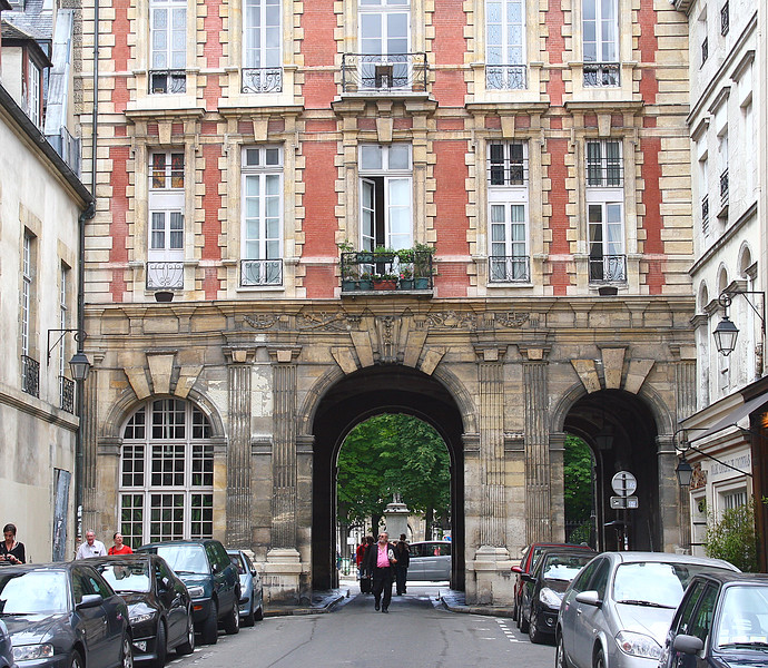 The entrance to Place des Vosges, a lovely square in the city