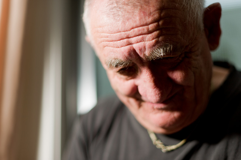 Fine art portrait of a man in his late sixties, shot with a very shallow depth of field so that only his eyebrows are in focus.