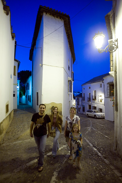 Visitors walking at dusk, town of Ronda, province of Malaga, Andalusia, Spain