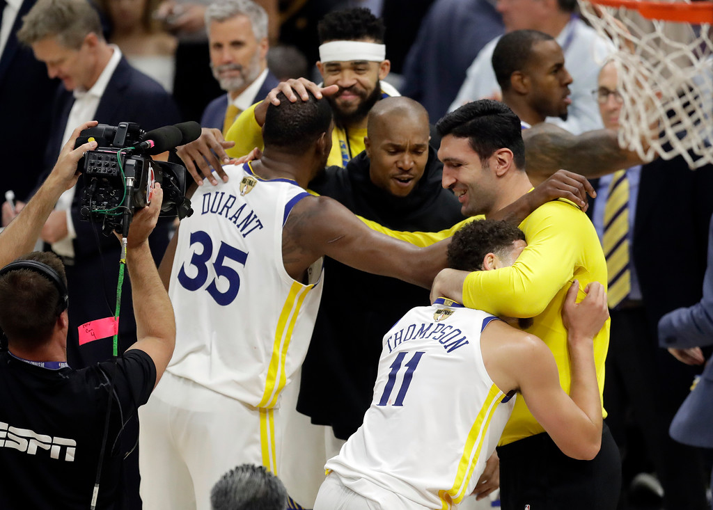 . Golden State Warriors\' Kevin Durant (35) celebrates with teammates following Game 4 of basketball\'s NBA Finals against the Cleveland Cavaliers, Friday, June 8, 2018, in Cleveland. The Warriors defeated the Cavaliers 108-85 and swept the series. (AP Photo/Tony Dejak)