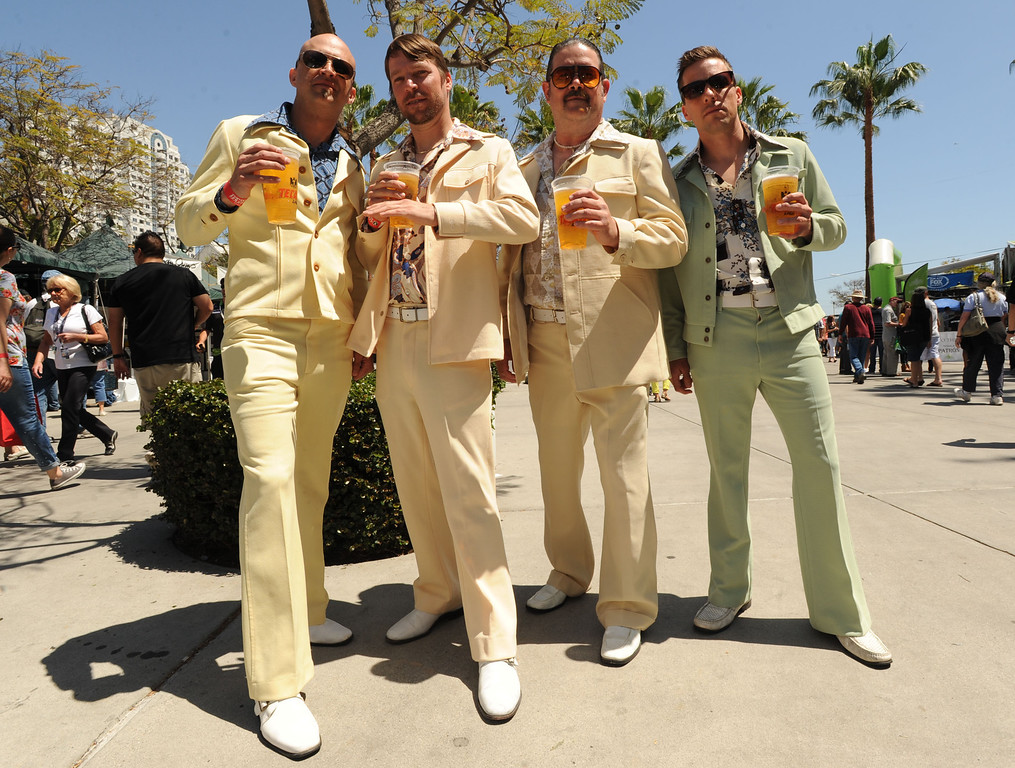. Long Beach, Calif., -- 04-20-13-    From  left to right, Brett Seaton, Nathan Lamar, Jon Lee and  Jacob Lamar are members of the National Institute for the Preservation of Leisure Suits ( N. I. P. L. S  ) Saturday at the 39 Annual Toyota Grand Prix of Long Beach. 