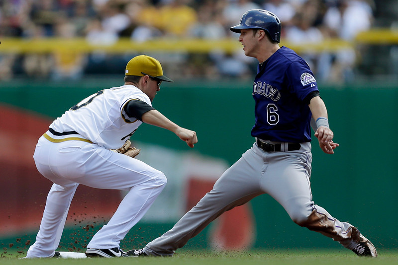 . Colorado Rockies\' Corey Dickerson (6) is caught attempting to steal second by Pittsburgh Pirates shortstop Jordy Mercer (10) in the first inning of a baseball game in Pittsburgh Sunday, Aug. 4, 2013. (AP Photo/Gene J. Puskar)