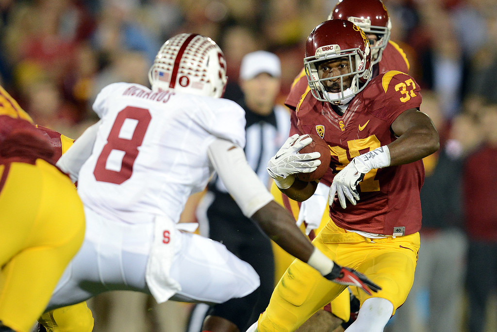 . USC�s Javorius Allen #37 looks for some running room as Stanford�s Jordan Richards #8 move in for the stop during their game at the Los Angeles Memorial Coliseum Saturday, November 16, 2013. (Photos by Hans Gutknecht/Los Angeles Daily News)