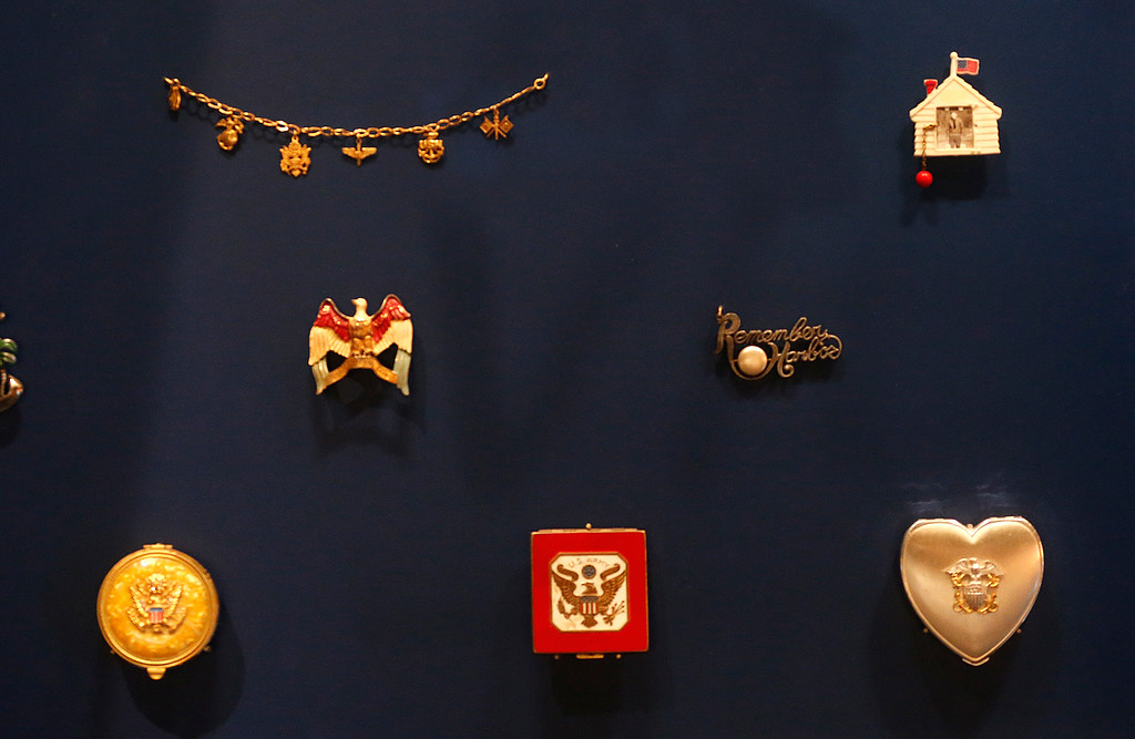 ". ""Sweetheart Jewelry,\"" given by soldiers to their mothers, sisters, wives and sweethearts, which often had insignia identifying branch, and sometimes unit and job, is part of the permanent exhibit \""Salute to the Home Front\"" at the National World War II Museum, which will open to the public this Saturday, in New Orleans, Monday, June 5, 2017. The exhibit tells the home front story from the 1920s to the development of the atomic bomb. (AP Photo/Gerald Herbert)"