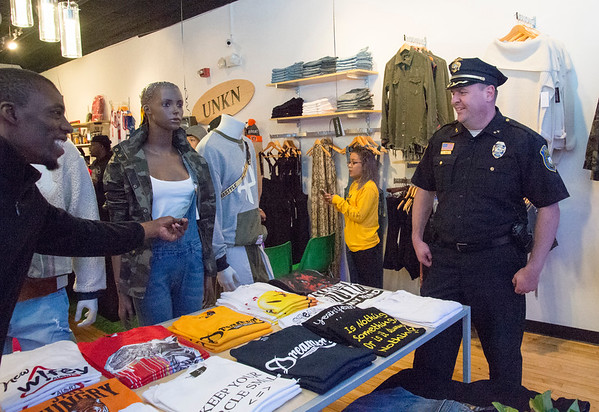 10/17/19 Wesley Bunnell | StaffrrNew Britain's newest clothing store, Un Known, opened on Main St with a ribbon cutting on Thursday afternoon. Deivone Tanksley Sr. L, points out clothing to Police Chief Christopher Chute before the opening.