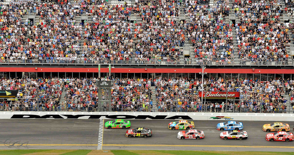 . NASCAR driver Danica Patrick (10) leads the field on the first lap during the NASCAR Sprint Cup Series Daytona 500 race at the Daytona International Speedway in Daytona Beach, Florida February 24, 2013. REUTERS/Brian Blanco