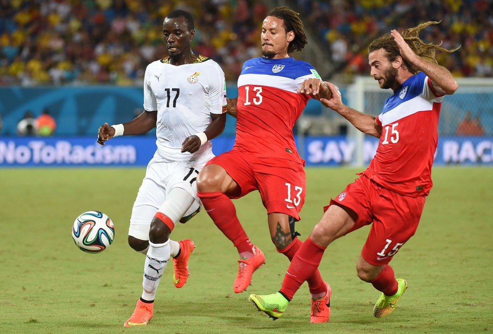 Description of . Ghana's midfielder Mohammed Rabiu (L) vies with US midfielder Jermaine Jones (C) and US midfielder Kyle Beckerman during a Group G football match between Ghana and US at the Dunas Arena in Natal during the 2014 FIFA World Cup on June 16, 2014.  AFP PHOTO / EMMANUEL DUNANDEMMANUEL DUNAND/AFP/Getty Images