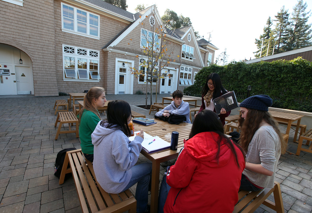 . Ninth graders work on assignments in the courtyard area during their free period at Head Royce School in Oakland, Calif. on Monday, Dec. 3, 2012.  Head Royce is in it\'s 125th year of operation. (Laura A. Oda/Staff)