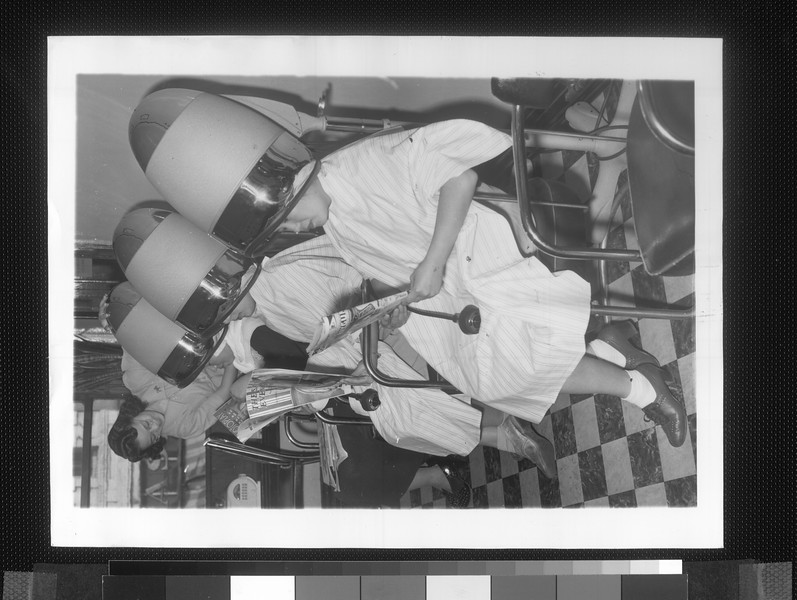 """""""Japanese ladies under driers at the Ginza Beauty Salon in Los Angeles.  Yoshi Muraoka, the operator, is a Nisei.""""--caption on photograph"""