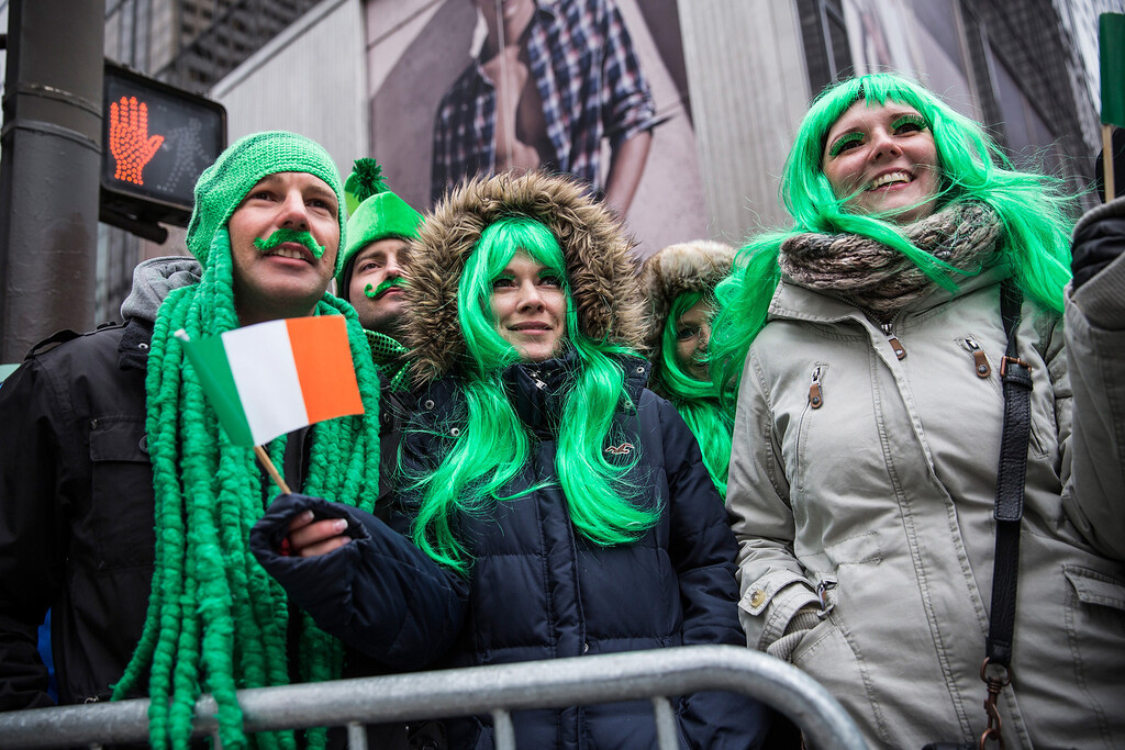 . Revelers watch the annual St. Patrick\'s Day Parade along Fifth Ave in Manhattan on March 17, 2014 in New York City.  (Photo by Andrew Burton/Getty Images)