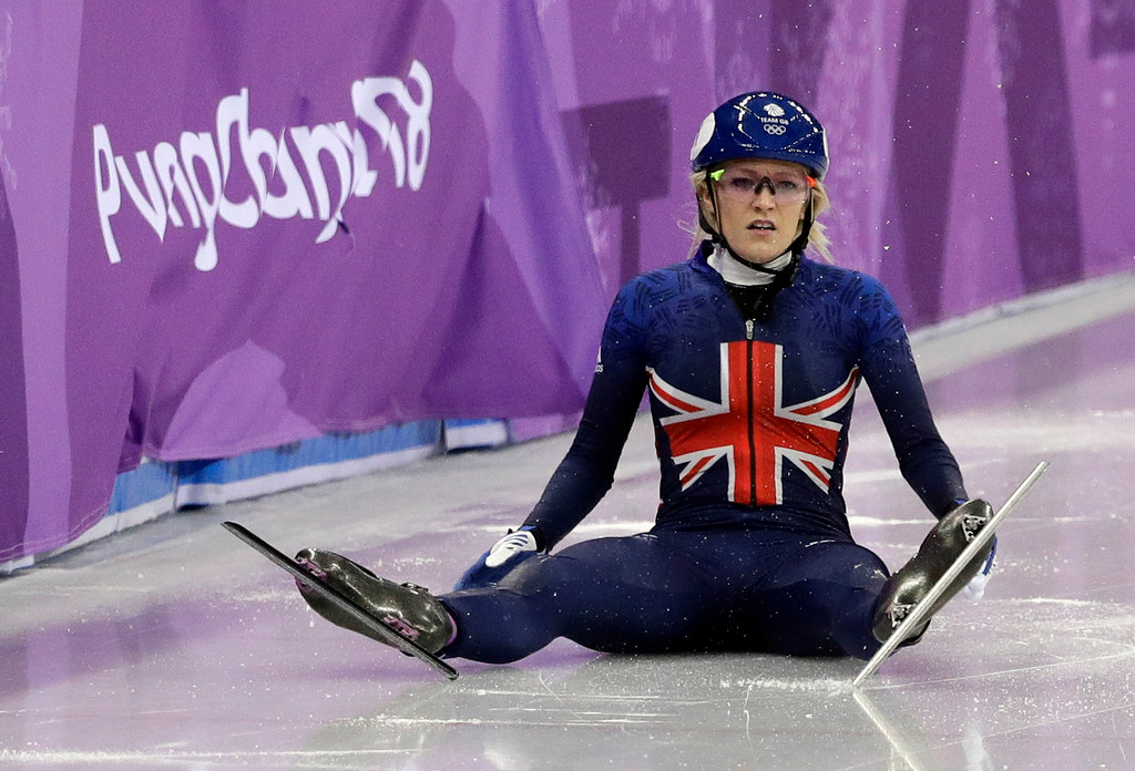 . Elise Christie of Britain sits on the ice after crashing during the ladies\' 500 meters short track speedskating final in the Gangneung Ice Arena at the 2018 Winter Olympics in Gangneung, South Korea, Tuesday, Feb. 13, 2018. (AP Photo/David J. Phillip)