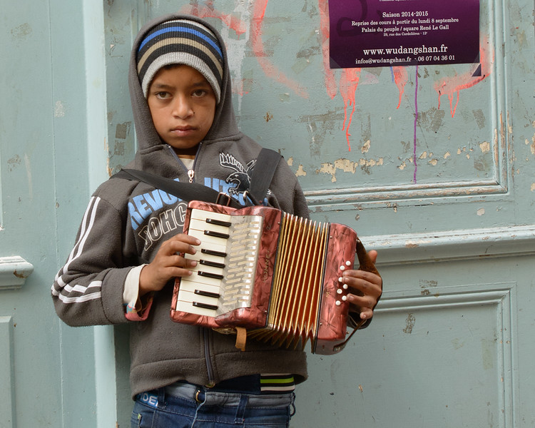 Young busker on Rue Mouffetard