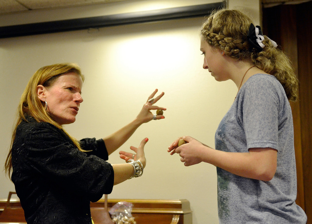 . Jeff Forman/JForman@News-Herald.com Skok shows Michaela a walnut that she will use in singing exercise.
