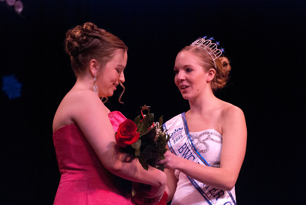 . Kayla Rice/Reformer Katie Burroughs is congratulated by 2013 Winter Carnival Queen Alison Cornellier after being announced as the runner up during the Queen\'s pageant on Friday evening.