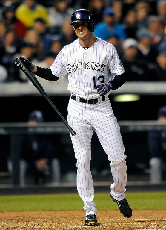. Colorado Rockies\' Drew Stubbs grimaces after striking out in the fifth inning of a baseball game against the San Diego Padres Friday, Sept. 5, 2014, in Denver. (AP Photo/Chris Schneider)