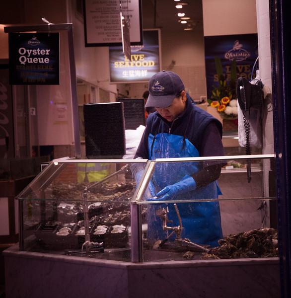 Oyster shucker at the Sydney Fish Market