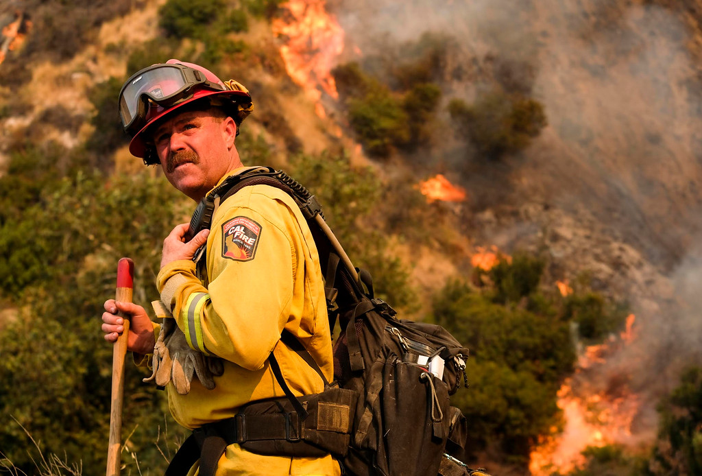 . A crew member with California Department of Forestry and Fire Protection (Cal Fire) battles a brushfire on the hillside in Burbank, Calif., Saturday, Sept. 2, 2017.  Several hundred firefighters worked to contain a blaze that chewed through brush-covered mountains, prompting evacuation orders for more than 600 homes in Los Angeles, Burbank and Glendale. (AP Photo/Ringo H.W. Chiu)