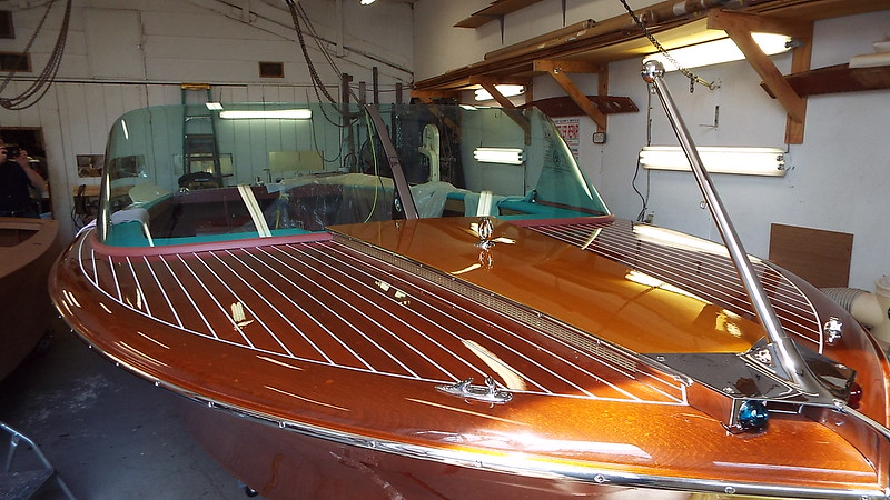 Starboard front deck with the new windshield and new rubber trim installed.