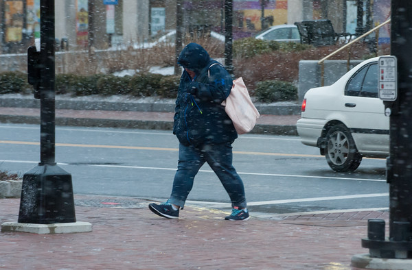 03/21/18 Wesley Bunnell | Staff A CT Transit passenger makes their way down Bank Street towards their bus during the beginning of snow flurries on Wednesday evening. The expected nor'easter started late in the day after many businesses and schools closed early for the day.