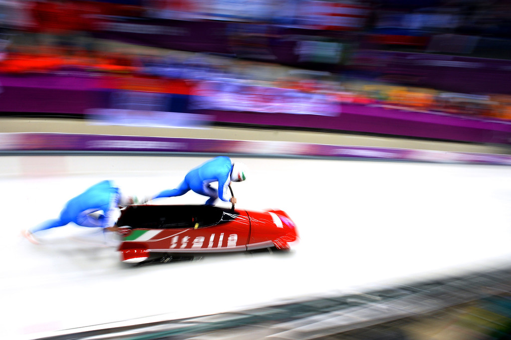 . Pilot Alexander Kasjanov and Maxim Belugin of Russia team 2 make a run during the Men\'s Two-Man Bobsleigh heats on Day 9 of the Sochi 2014 Winter Olympics at Sliding Center Sanki on February 16, 2014 in Sochi, Russia.  (Photo by Pascal Le Segretain/Getty Images)