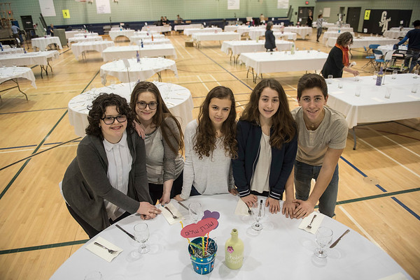 DAVID LIPNOWSKI / WINNIPEG FREE PRESS  (Left to Right) Volunters Noya Haims, Romi Haims, Lise Conner, Lena Steinberg, Uri Faingold, set up a Shabbat table at the Rady Jewish Community Centre Friday March 3, 2017 in preparation for a community wide Shabbat dinner where 400 attendees are expected. Winnipeg synagogues are cooperating on this event, and similar events  across Canada and the US are happening on Friday night as well.