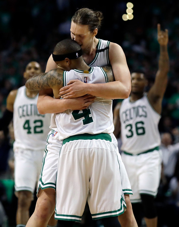 . Boston Celtics guards Isaiah Thomas (4) and Marcus Smart (36), and center Al Horford (42) celebrate with center Kelly Olynyk after Olynyk sank a basket during the fourth quarter of Game 7 of a second-round NBA basketball playoff series against the Washington Wizards, Monday, May 15, 2017, in Boston. (AP Photo/Charles Krupa)