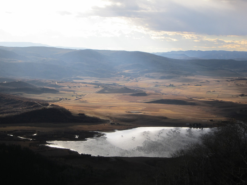 No photos of the ride through the storm, I needed both hands and all my concentration, but after summiting the pass I begin the descent to Steamboat Springs. Suddenly, the clouds part and this beautiful scene is revealed. The surface of the lake shows the intensity of the winds.