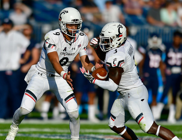 9/29/2018 Mike Orazzi | Staff Cincinnati's Desmond Ridder (9) and Michael Warren II (3) Saturday at UConn.