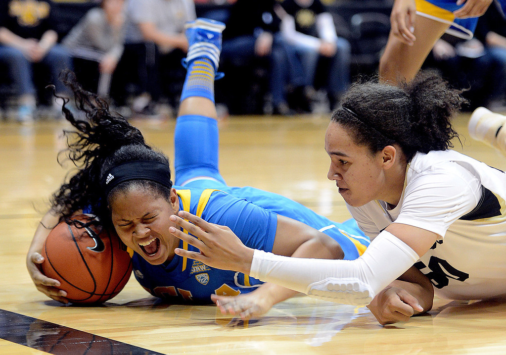 . UCLA\'s Dominique Williams, left, tries to keep the ball away from Colorado\'s Jamee Swan during the first half of an NCAA college basketball game Friday, Feb. 28, 2014, in Boulder, Colo. (AP Photo/Daily Camera, Cliff Grassmick)