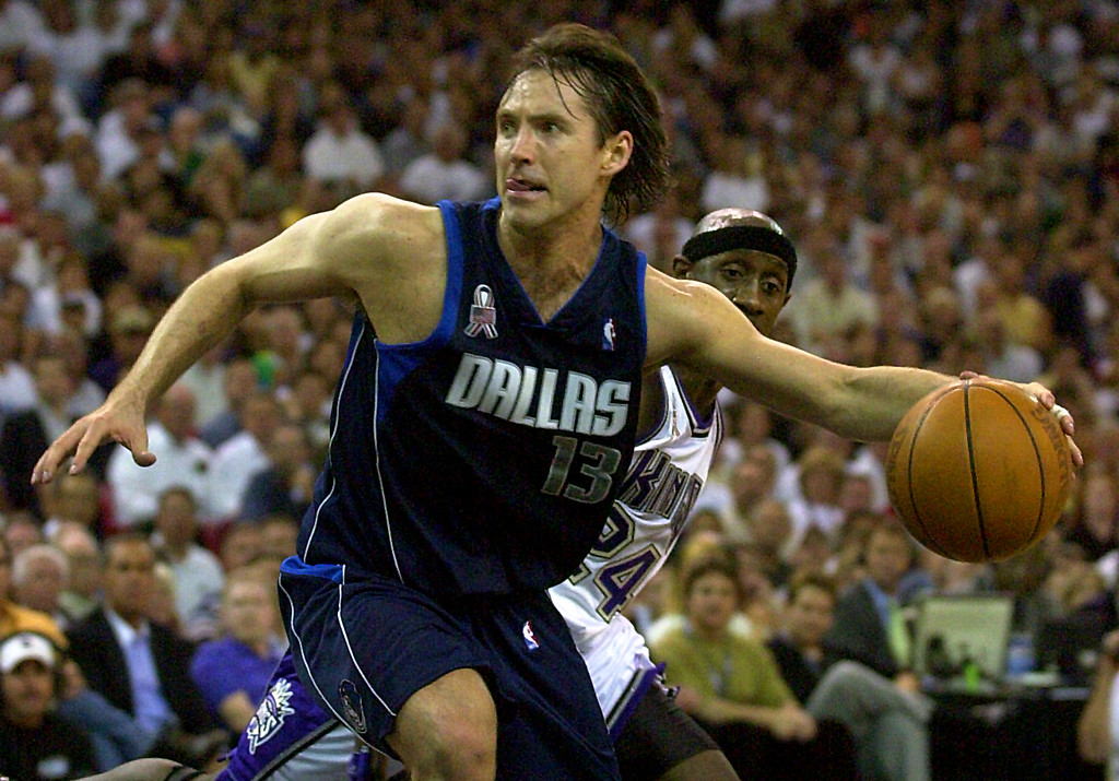 . Dallas Mavericks guard Steve Nash works the ball in the final moments of Game 2 of their Western Conference semifinal against the Sacramento Kings in Sacramento, Calif., Monday, May 6, 2002. Nash scored 30 points as Dallas won the game 110-102 to even the series at 1-1.  (AP Photo/Rich Pedroncelli)