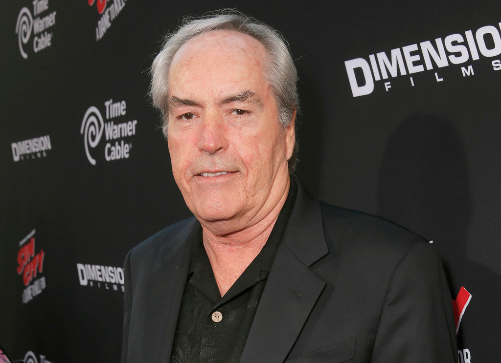 """. FILE - In this Aug. 19, 2014 file photo, actor Powers Boothe attends the Los Angeles premiere of \""""Sin City: A Dame To Kill For\"""" in Los Angeles. Boothe, the character actor known for his villain roles in TV�s �Deadwood,� and in the movies �Tombstone,� �Sin City� and �The Avengers,� died Sunday, May 14, 2017. He was 68. (Photo by Todd Williamson/Invision/AP, File)"""