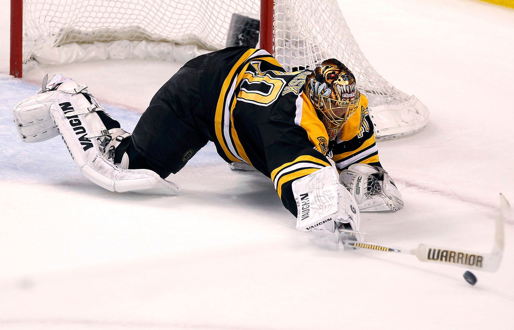 . Boston Bruins goalie Tuukka Rask makes a save against the Chicago Blackhawks during the third period in Game 3 of their NHL Stanley Cup Finals hockey series in Boston, Massachusetts, June 17, 2013. REUTERS/Adam Hunger