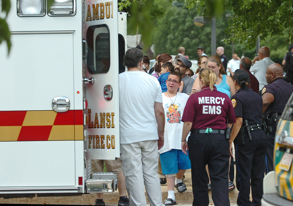 . People are evacuated from the Sister Marie Lenahan Wellness Center in Yeadon on the campus of Mercy Fitzgerald Hospital after police say a man opened fire Thursday. (Times Staff / JULIA WILKINSON)