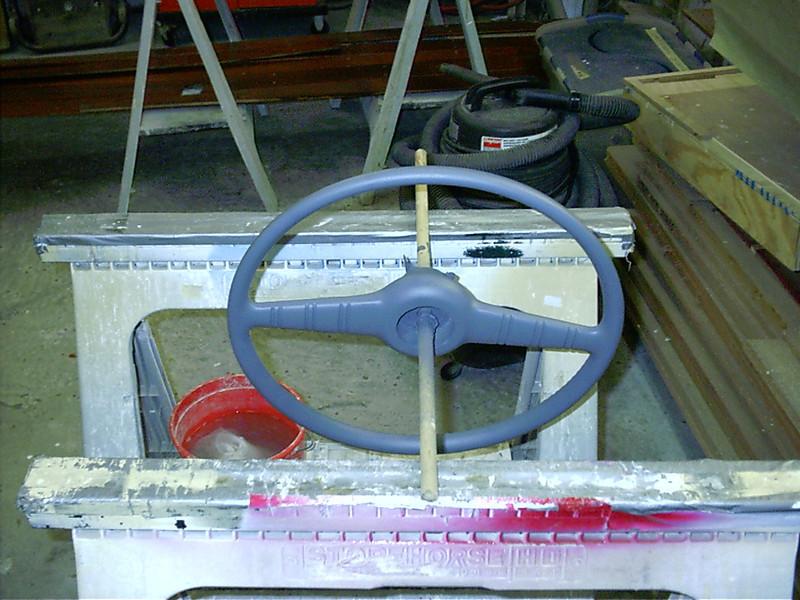 Front view of steering wheel being rebuilt.