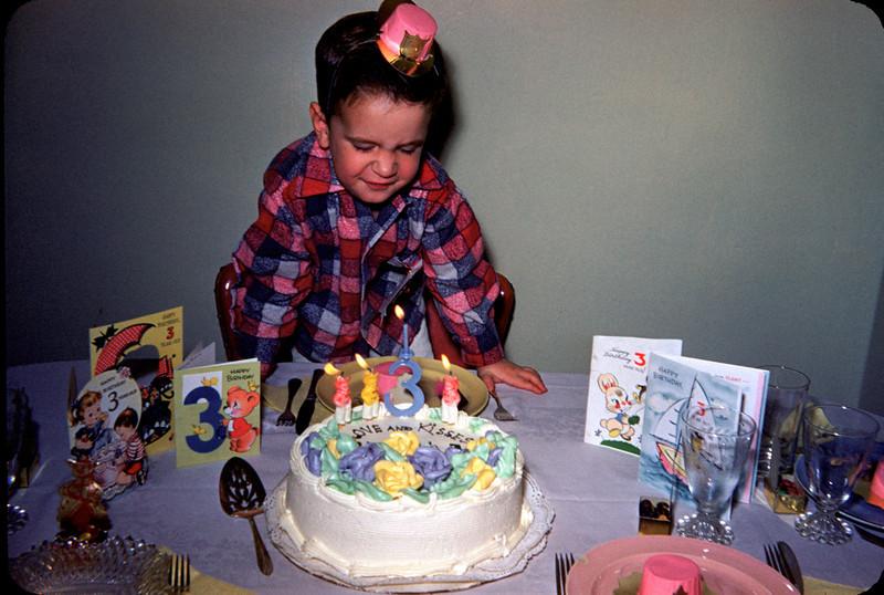 richard's 3rd birthday blowing candles.jpg
