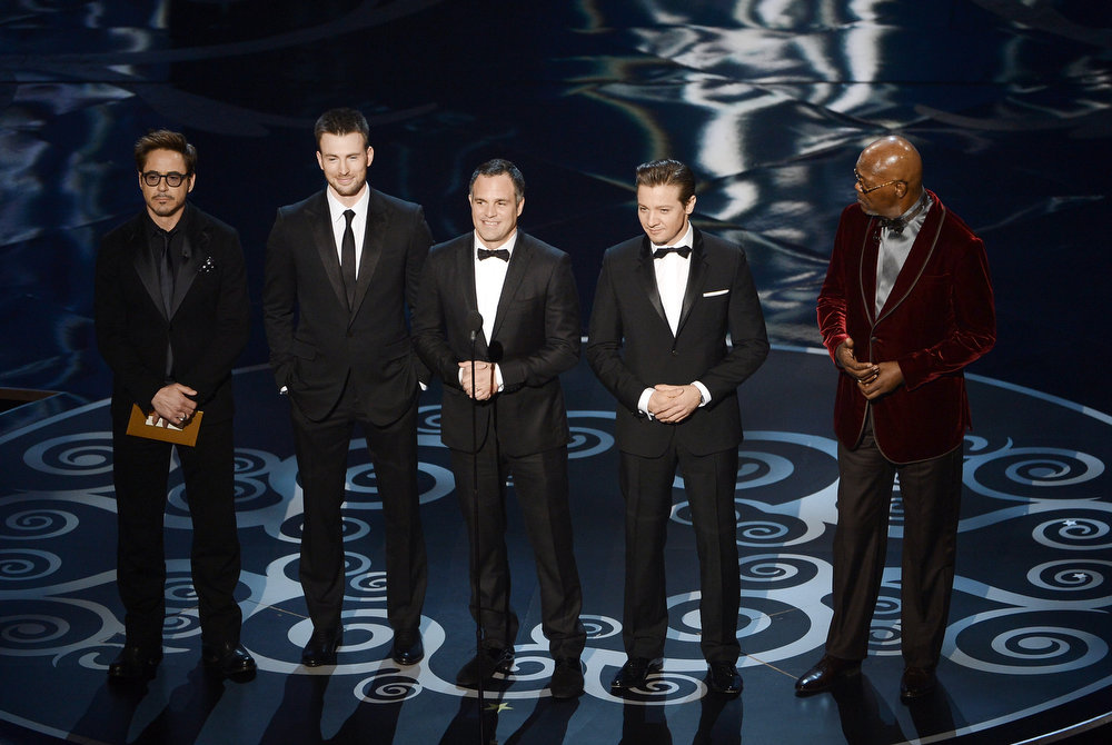 . Actors Robert Downey Jr., Chris Evans, Mark Ruffalo, Jeremy Renner and Samuel L. Jackson present onstage during the Oscars held at the Dolby Theatre on February 24, 2013 in Hollywood, California.  (Photo by Kevin Winter/Getty Images)