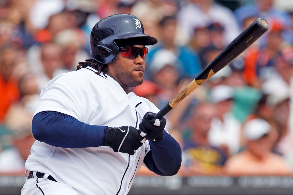 . Detroit\'s Prince Fielder connects for an RBI single, scoring teammate Austin Jackson in the third inning against the Twins. (AP Photo/Duane Burleson)