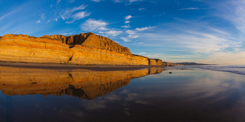 Low tide at Torrey Pines State Beach with La Jolla in the background. This is a 180 degree view taken with a 15mm fisheye .