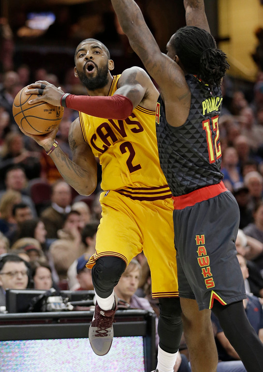 . Cleveland Cavaliers\' Kyrie Irving (2) drives past Atlanta Hawks\' Taurean Prince in the second half of an NBA basketball game, Friday, April 7, 2017, in Cleveland. (AP Photo/Tony Dejak)