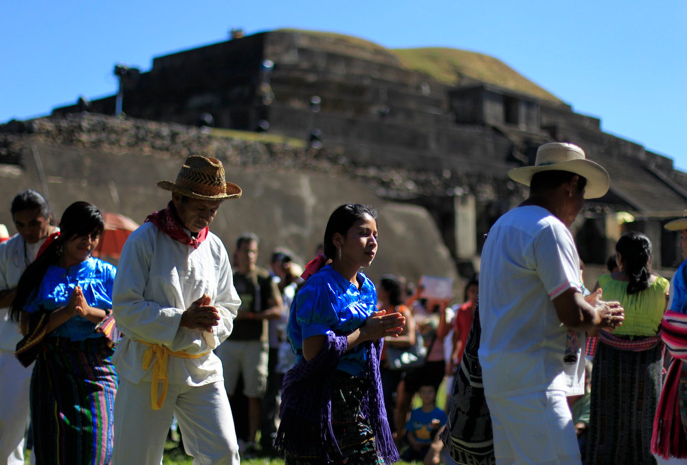 . Pipil Mayans perform a dance during a ceremony at the Maya archeological site of Tazumal in Santa Ana, about 75 km (46.6 miles) away from San Salvador, El Salvador, December 21, 2012. Mystics, hippies and tourists descended on the ruins of Maya cities to mark the close of the 13th bak\'tun - a period of around 400 years - and many hoped it would lead to a better era for humanity. This week, at sunrise on Friday, December 21, an era closes in the Maya Long Count calendar, an event that has been likened by different groups to the end of days, the start of a new, more spiritual age or a good reason to hang out at old Maya temples across Mexico and Central America.  REUTERS/Ulises Rodriguez