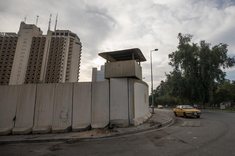 Blast walls and a watchtower outside the famous Hotel Palestine in Central Baghdad. Built in 1982 and originally operated by the French hotelier Le Méridien as the Palestine Méridien Hotel until UN sanctions were imposed following the first Gulf War.