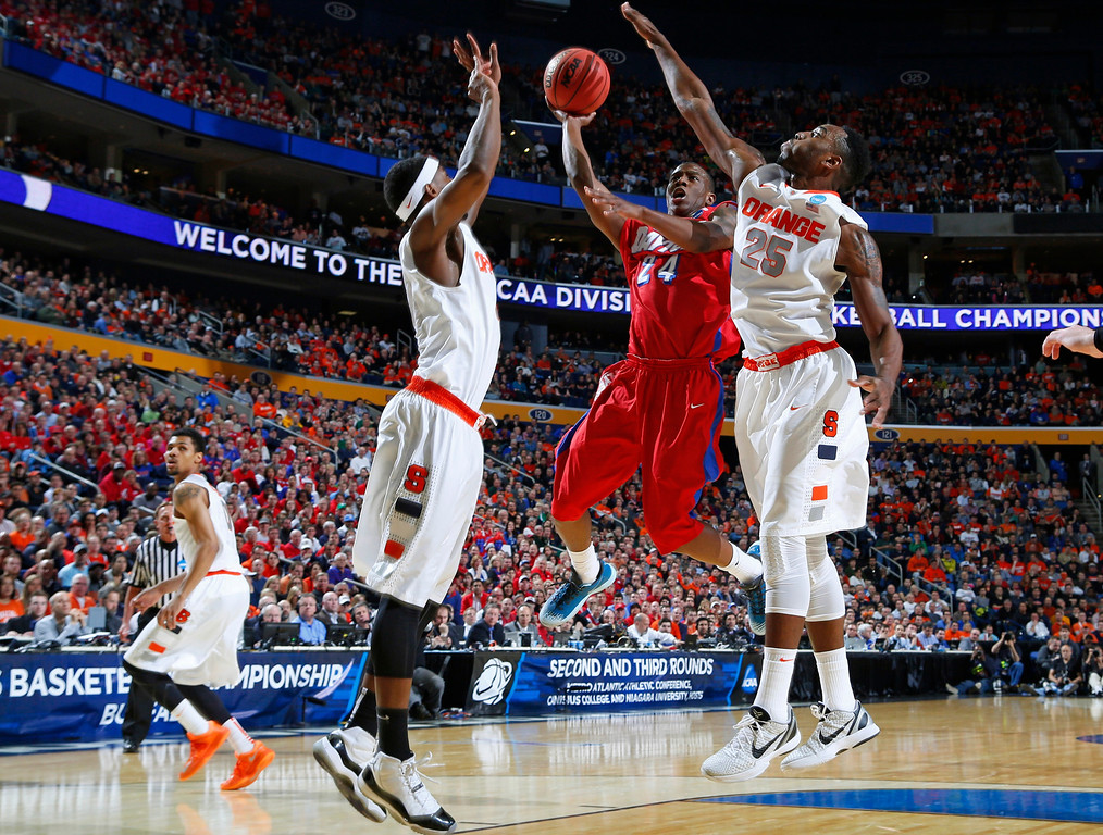 . Dayton\'s Jordan Sibert (24) drives past Syracuse\'s Rakeem Christmas (25) during the first half of a third-round game in the NCAA men\'s college basketball tournament in Buffalo, N.Y., Saturday, March 22, 2014. (AP Photo/Bill Wippert)