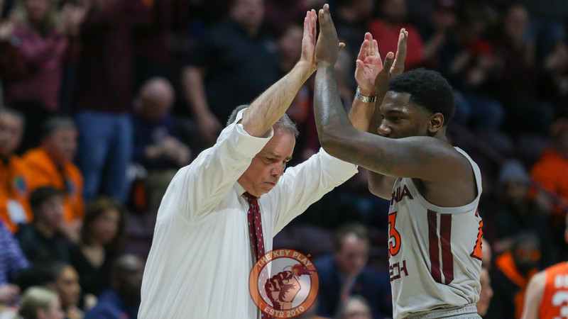 Head coach Mike Young high fives Tyrece Radford at the start of a media timeout. (Mark Umansky/TheKeyPlay.com)