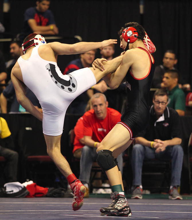 . James Logan\'s Artemio Flores, right, wrestles, Bella Vista\'s Victor Trujillo in a 126-pound fifth place match during the California Interscholastic Federation wrestling championships in Bakersfield, Calif., on Saturday, March 2, 2013. Trujillo would go onto win the match. (Anda Chu/Staff)