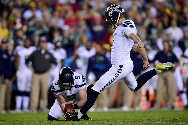 . LANDOVER, MD - OCTOBER 06: Kicker Steven Hauschka #4 of the Seattle Seahawks kicks a field goal in the second quarter of a game against the Washington Redskins at FedExField on October 6, 2014 in Landover, Maryland.  (Photo by Patrick Smith/Getty Images)