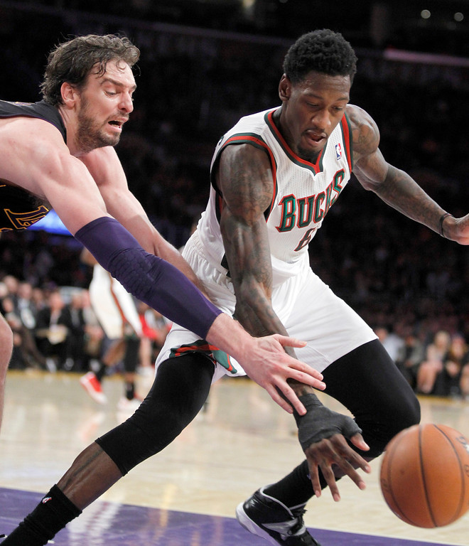 . Los Angeles Lakers center Pau Gasol, left, battles for the ball with Milwaukee Bucks center Larry Sanders during the second half of an NBA basketball game Tuesday, Dec. 31, 2013, in Los Angeles. The Bucks won 94-79. (AP Photo/Alex Gallardo)