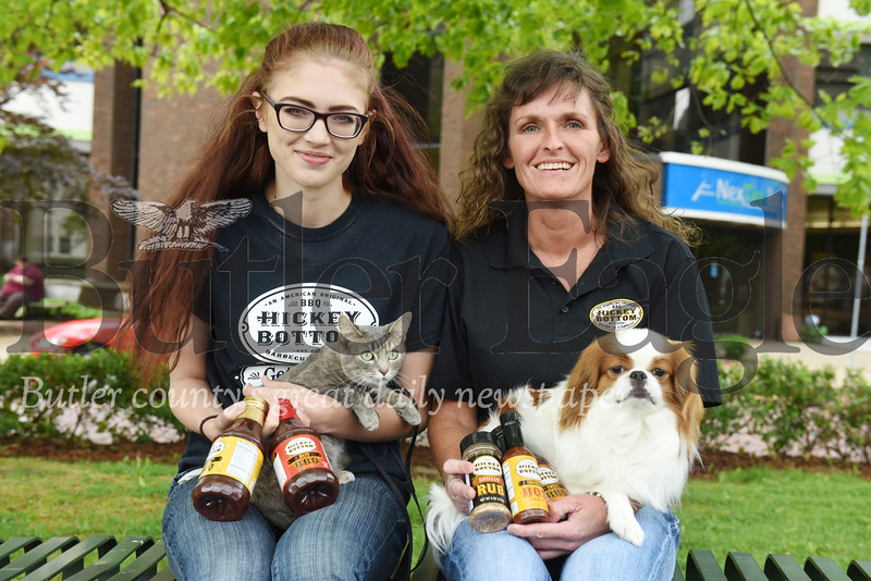 "Harold Aughton/Butler Eagle: Lacey McCrea (left) and her cat, ""Baby Cat"" plans to drive the chase car as her aunt Rebecca McCrea of Fenelton, owner of Hickey Bottom Barbecue Company, and her dog, Arnie, a Japanese Chin, will walk across the country to raise funds for charity."