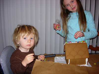 Jackson and Katie Building Gingerbread Houses