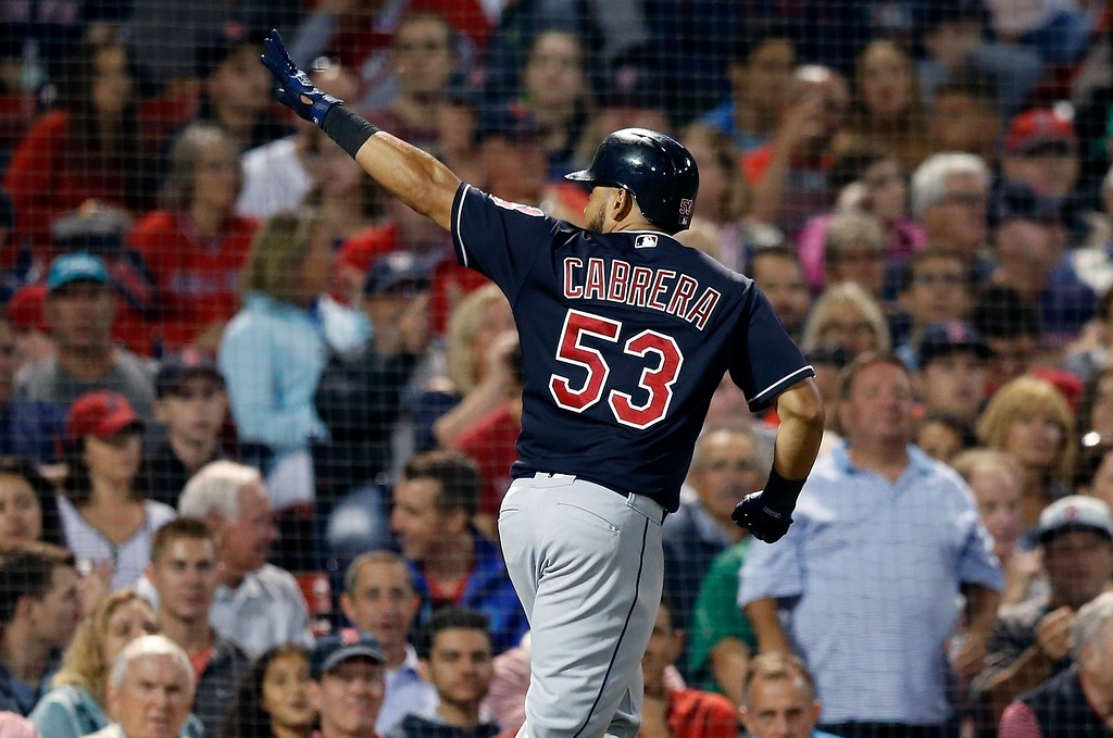 . Cleveland Indians\' Melky Cabrera celebrates his solo home run during the sixth inning of a baseball game against the Boston Red Sox in Boston, Tuesday, Aug. 21, 2018. (AP Photo/Michael Dwyer)