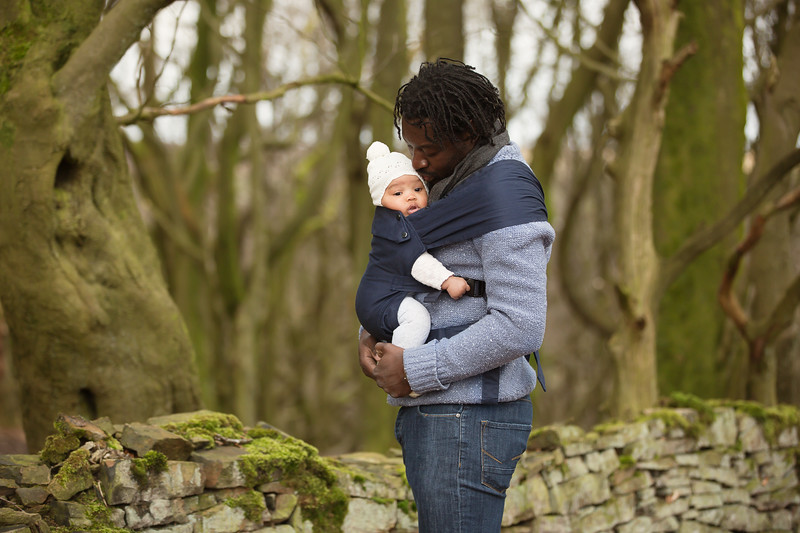 Izmi_Baby_Carrier_Cotton_Midnight_Blue_Lifestyle_Front_Carry_Dad_In_Woodland_With_Baby.jpg